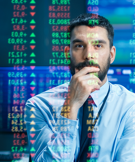 Man looking at trading data displayed on a reflective Surface