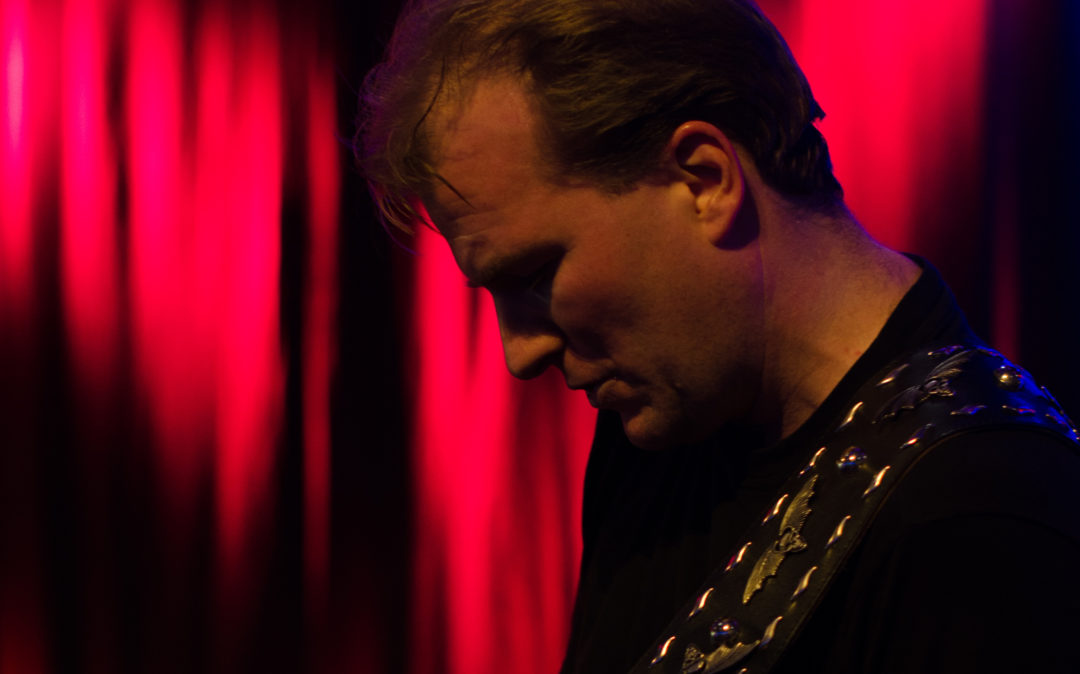 Picture of Jörg Wassink, Director Marketing & Communications at valantic, playing guitar