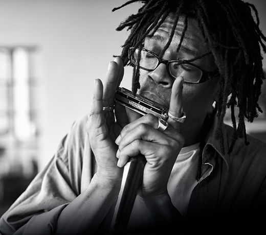 picture of a man playing harmonica