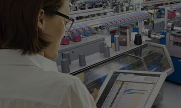 Picture of a woman with a tablet in a production plant, valantic Case Study Stoll