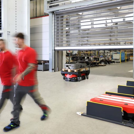Image of two people and automated guided vehicles at Grenzebach