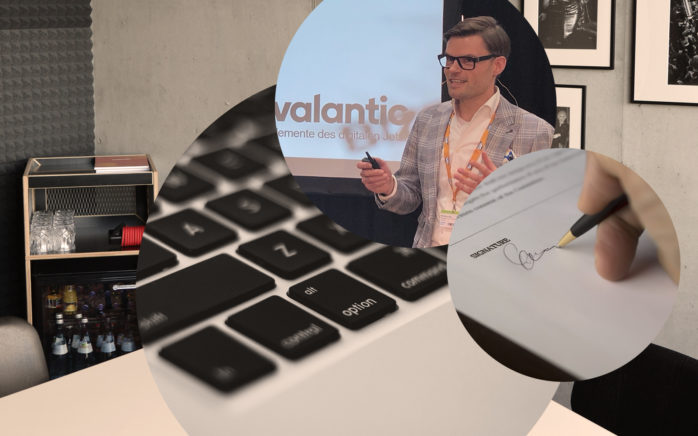 Bild von Matthias Bös, Solution Architect für SAP C/4HANA bei valantic Customer Engagement and Commerce, Laptop Tastatur, Unterschrift, Konferenzraum