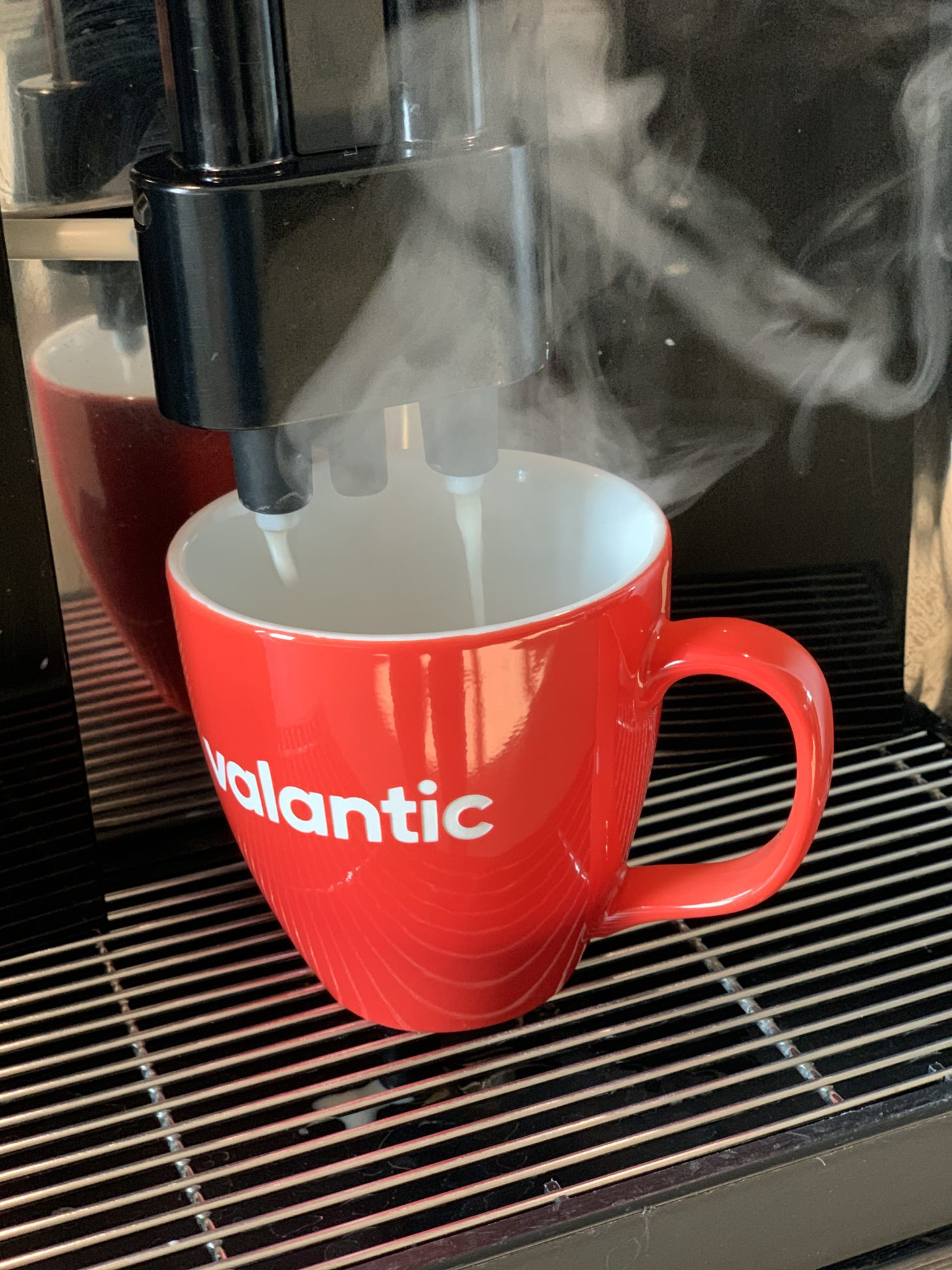 Image of a valantic cup under a coffee maker, office of valantic ERP Consulting in Cologne