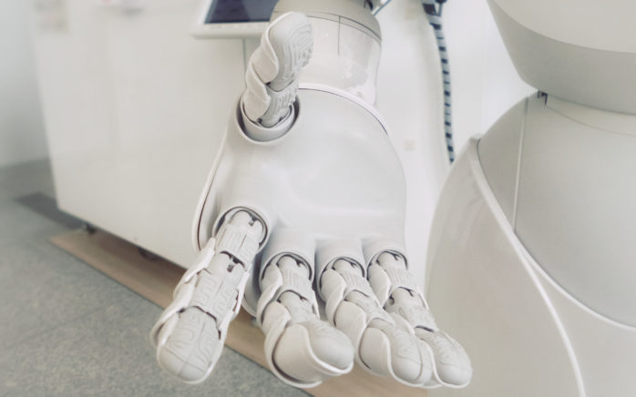"Image of a robotic arm, valantic blog article ""Process Automation"""