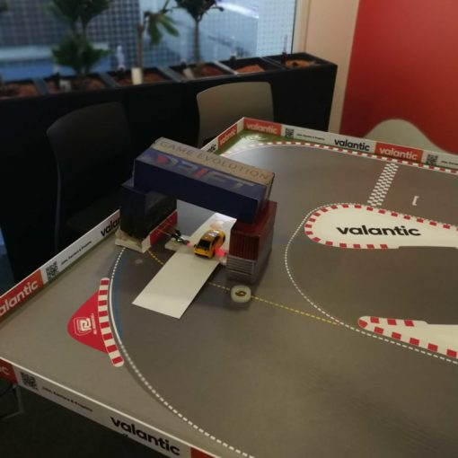 Picture of a toy car and a race track, valantic Dr!ft Showcase
