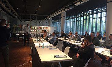 Bild von Personen in einem Seminar, valantic Supply Chain Excellence Day bei ERCO