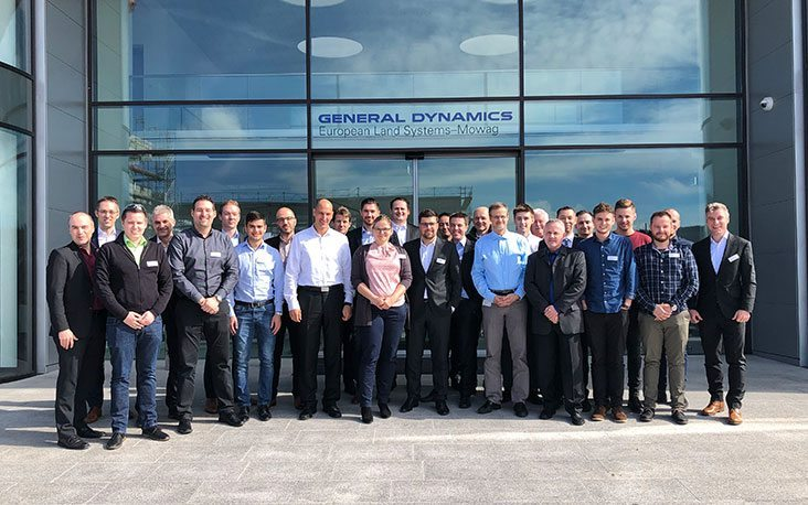 Picture of people in front of the General Dynamics building, valantic Supply Chain Excellence Day at General Dynamics