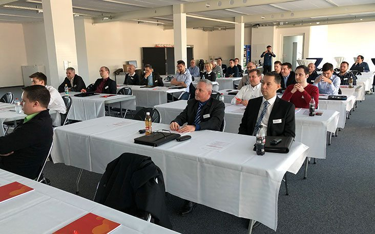 Pictures of people in a presentation, valantic Supply Chain Excellence Day at General Dynamics