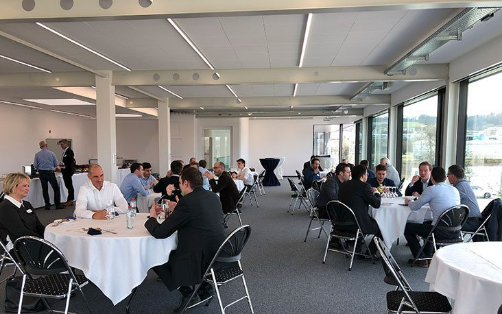 Picture of people sitting at tables and talking, valantic Supply Chain Excellence Day at General Dynamics