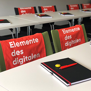 Picture of valantic branded things in a seminar room, valantic Supply Chain Excellence Day at SEW Eurodrive
