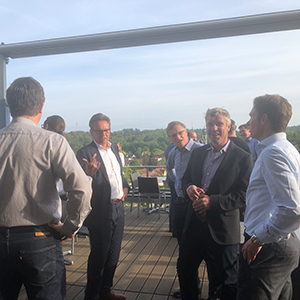Picture of people talking on a roof terrace, valantic Supply Chain Excellence Day at SEW Eurodrive