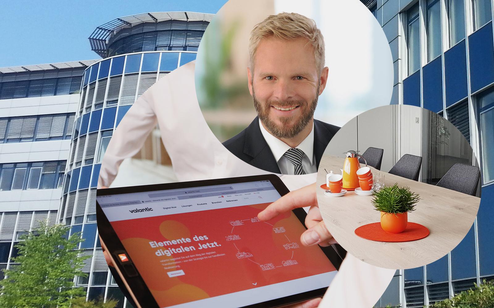Bild von Thomas Latajka, Geschäftsführer valantic ERP, Bürogebäude in Langenfeld, Konferenzraum, Tablet mit valantic Website