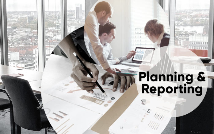 """Three pictures arranged in a circle show three people in front of an open laptop; a hand holding a pen; and the words """"planning & reporting"""". They represents the valantic Training Center offerings for planning & reporting seminars.ning & Reporting seminares."""