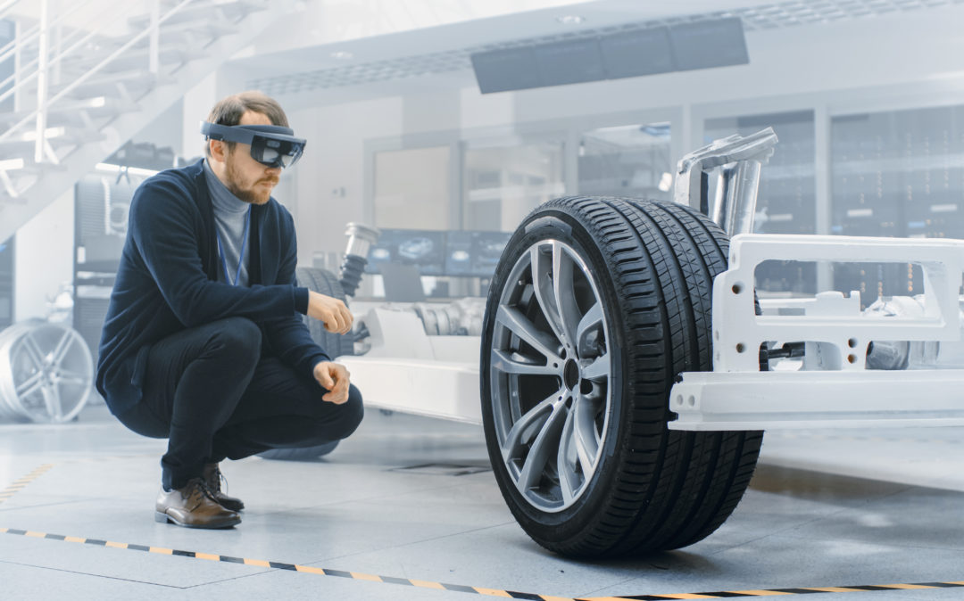 Image of an automotive engineer working on a car with the help of VR glasses, trends in the automotive industry: Industry 4.0
