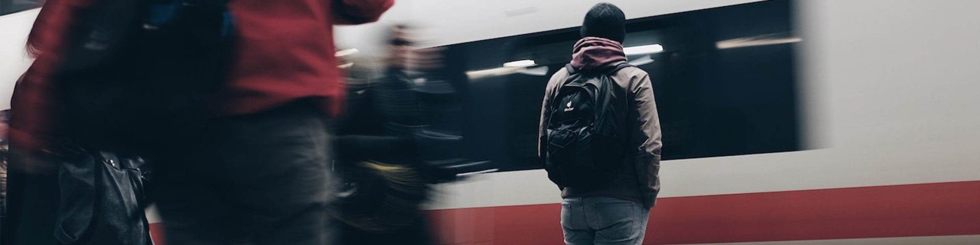 Picture of a waiting passenger on the train platform, valantic Case Study Siemens AG