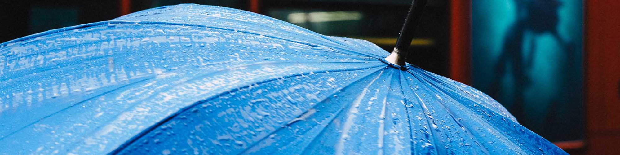 Picture of a wet blue umbrella, valantic Case Study Siemens AG