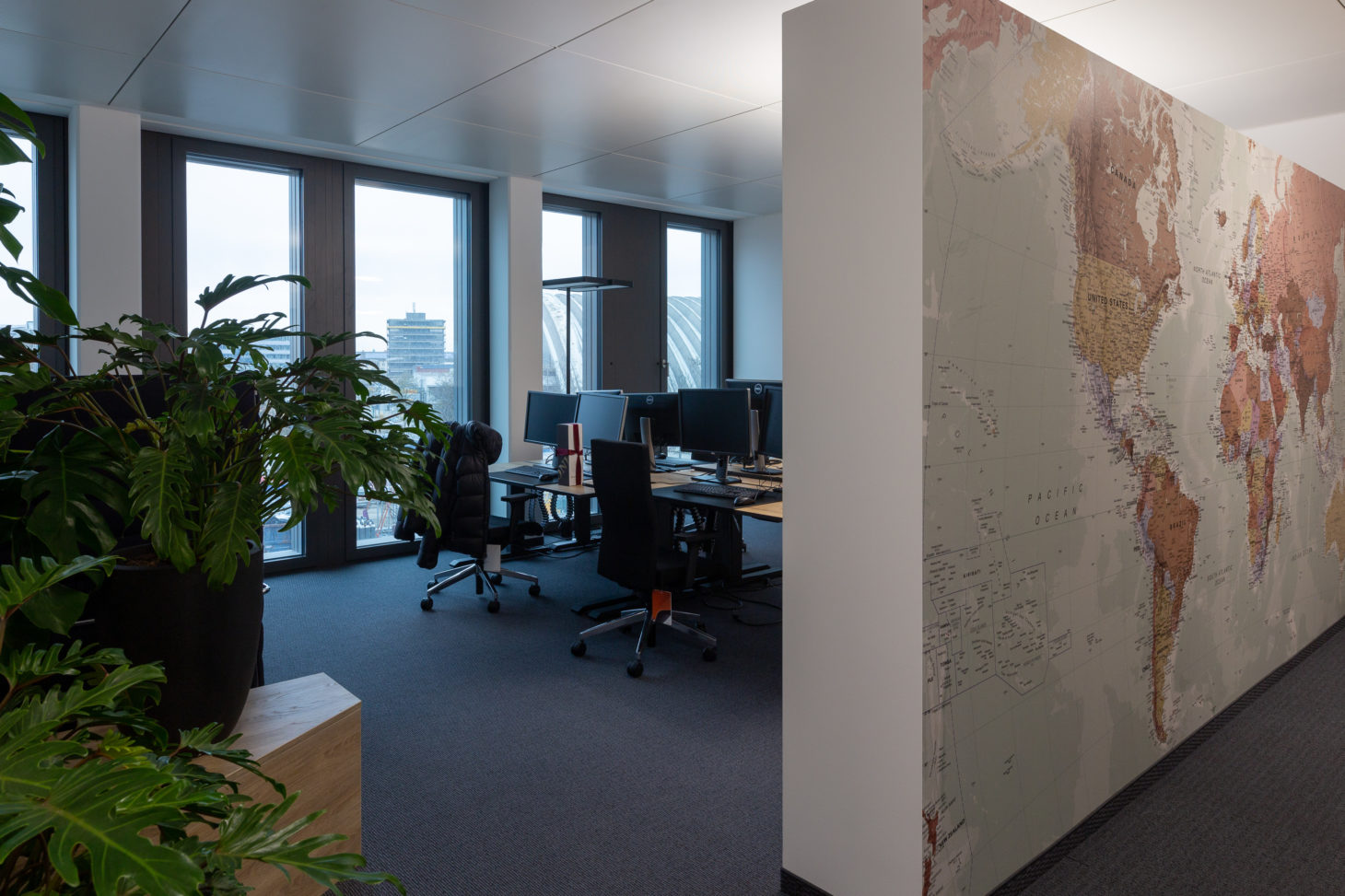 Picture of offices and world map, valantic branch Supply Chain Excellence Munich