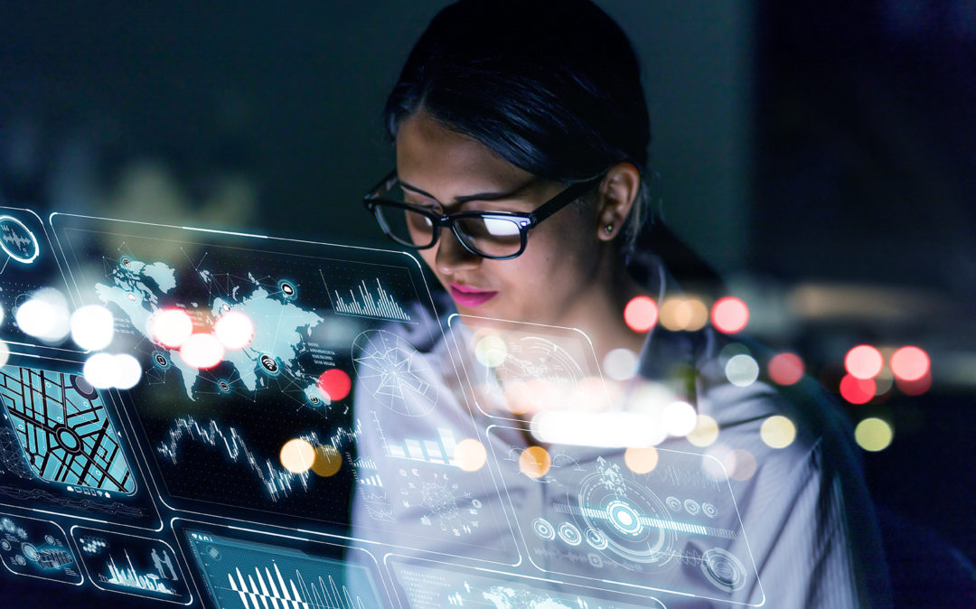 Image of a woman engineer looking at various information on screen with futuristic interface